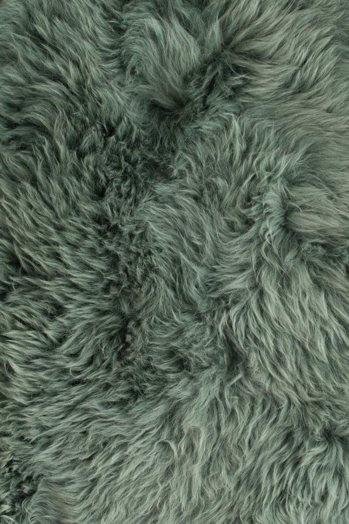 Zuiver schapenvacht evergreen groen detail